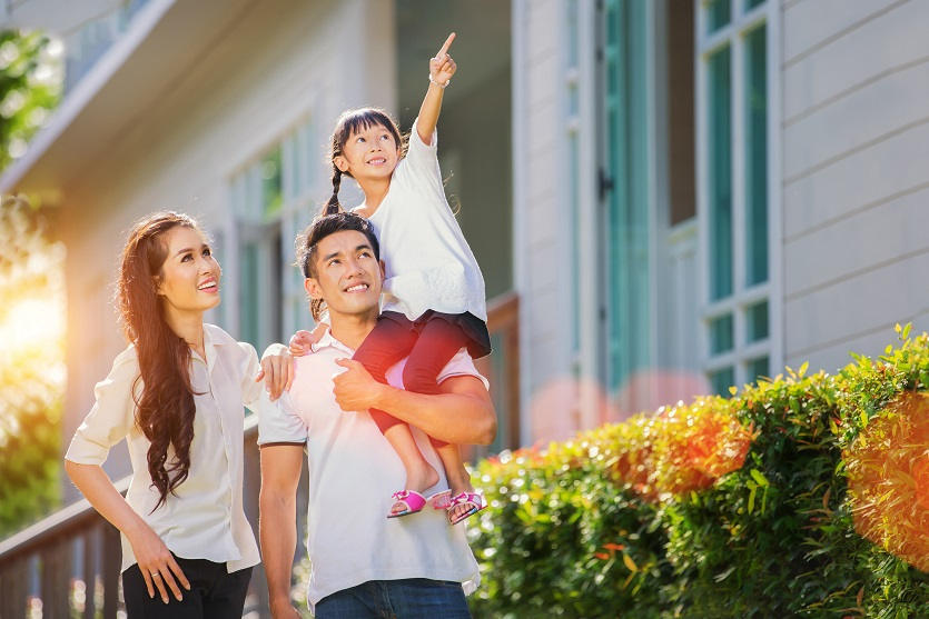 young-asian-family-homeowners-outside.jpg