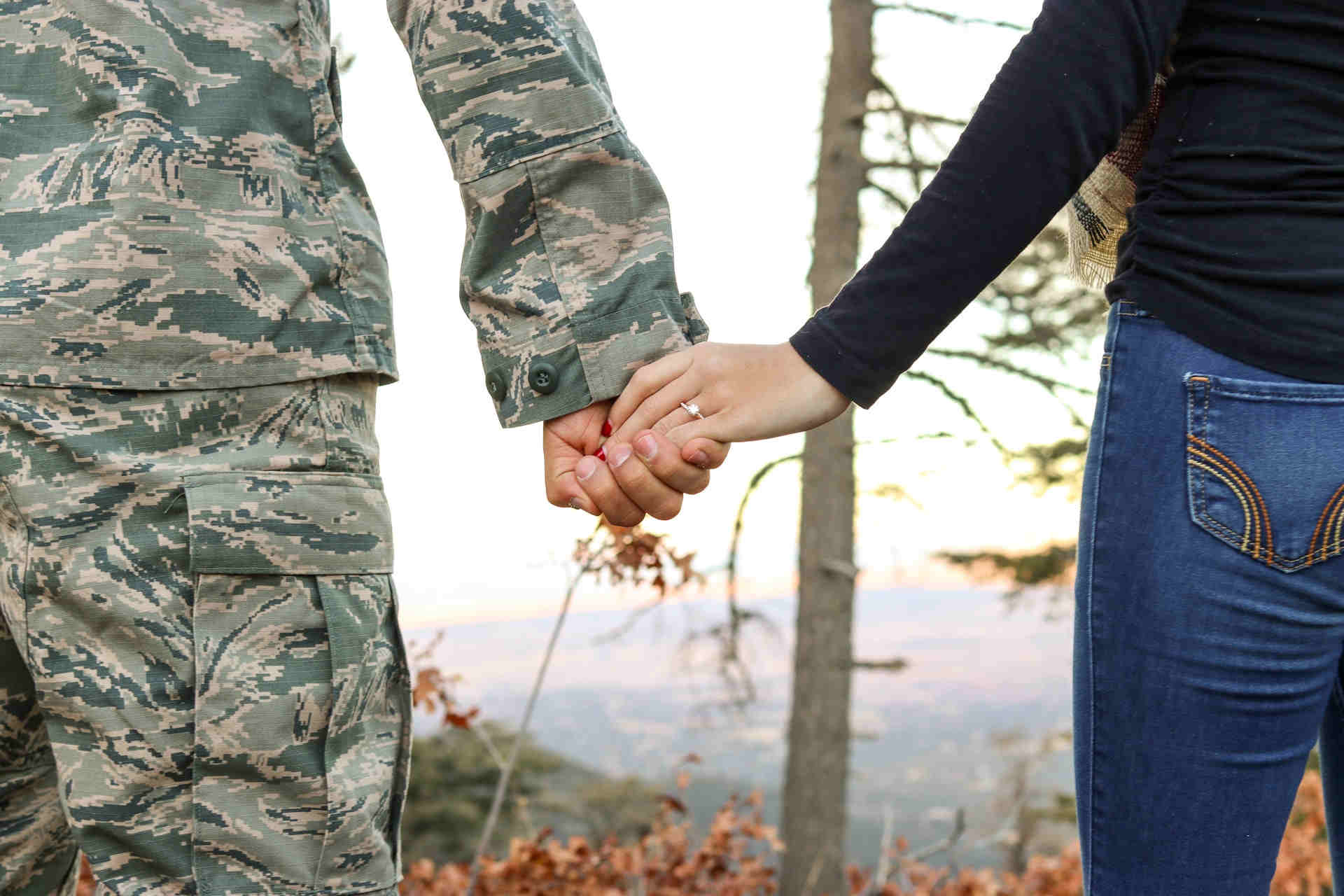 army man holding a woman's hand.jpeg