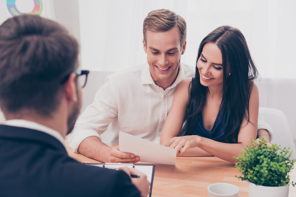 young couple looking at papers with service provider.jpg