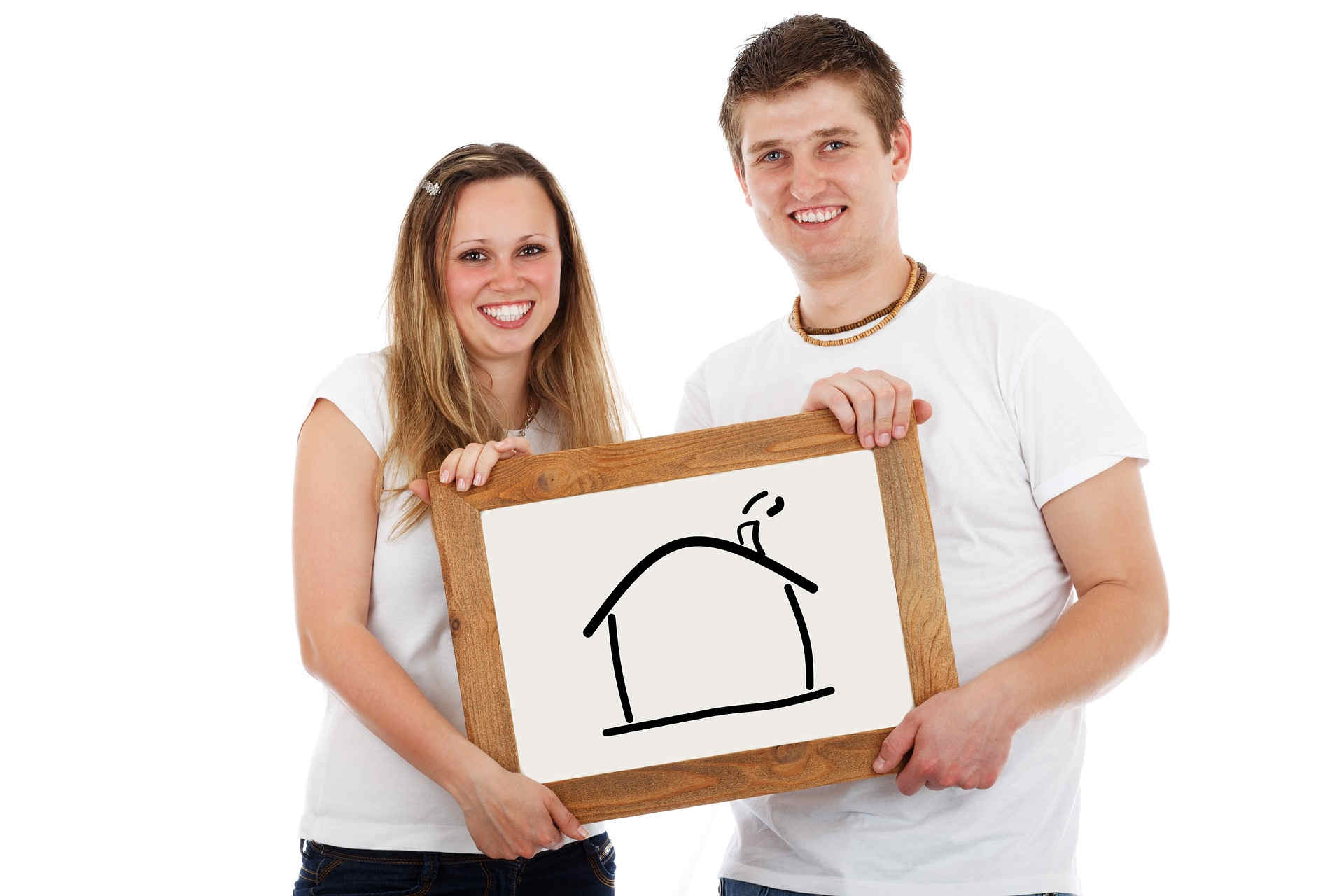 woman and man holding drawing of a house.jpg