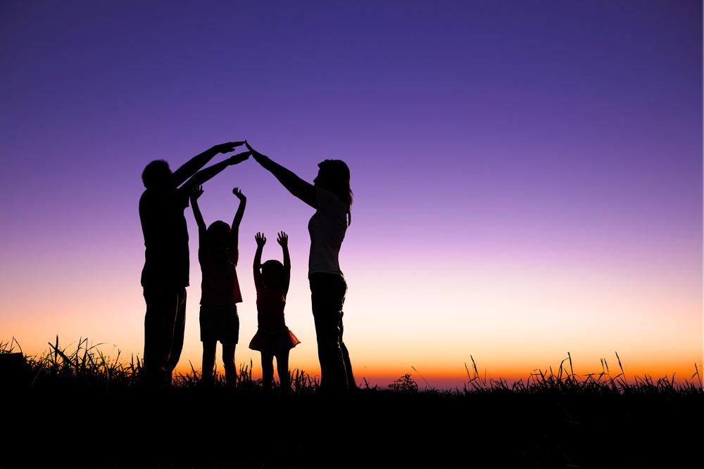 family-four-silouhette-outside-homeowners.jpg