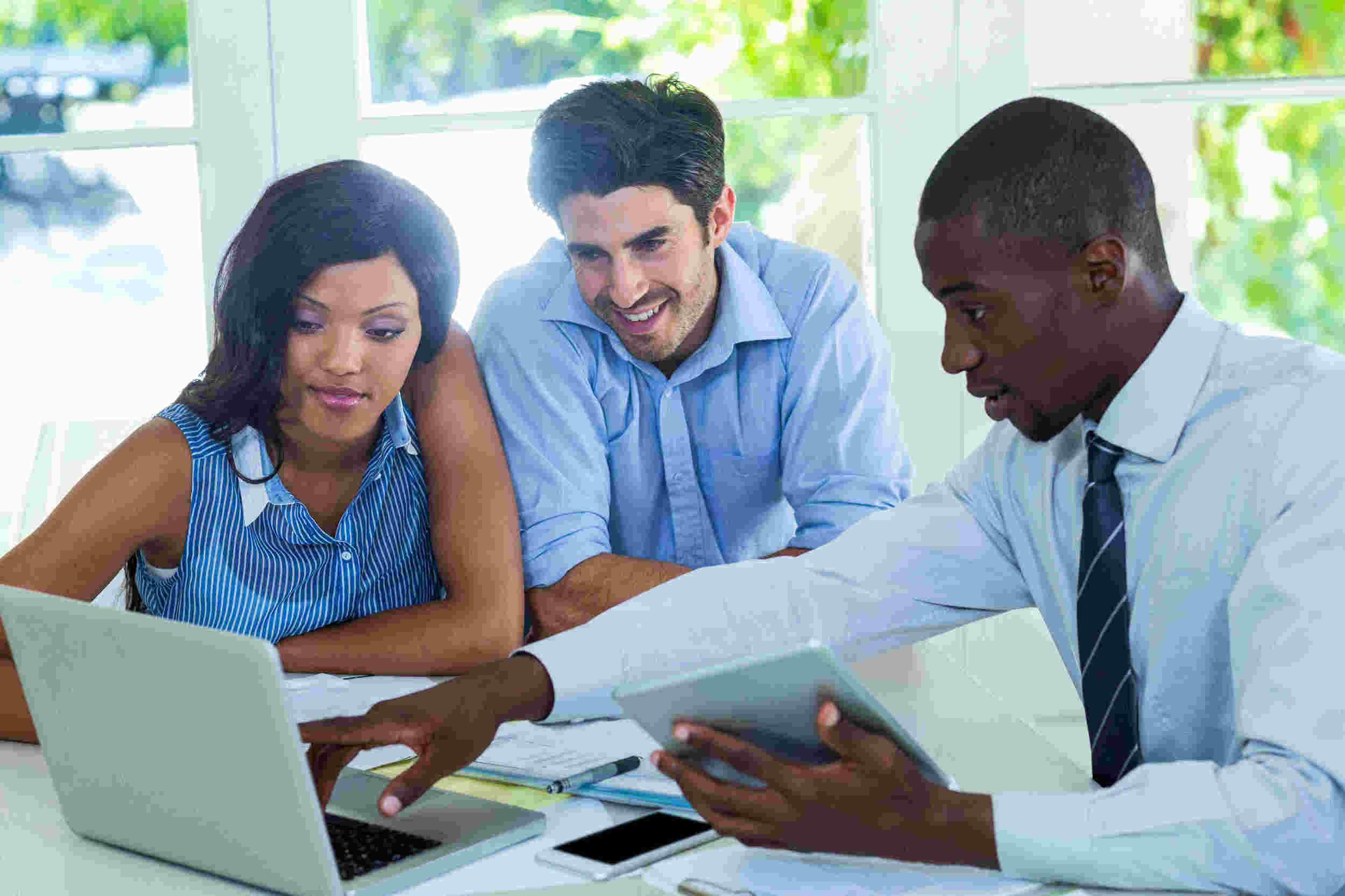 black professional pointing at laptop to a mixed couple.jpg