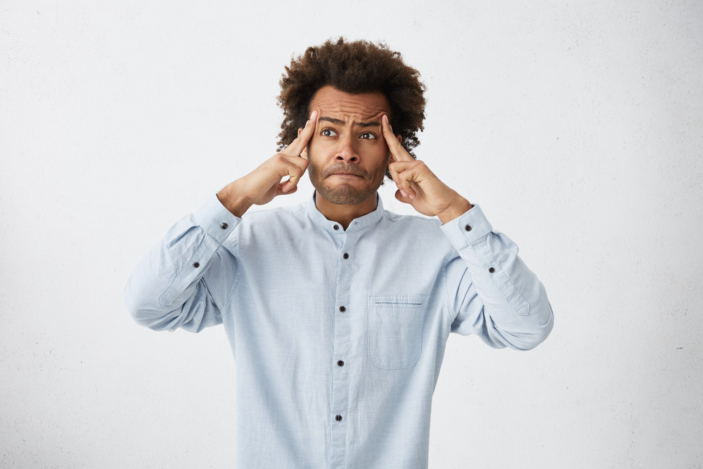 african american man with afro thinking.jpg