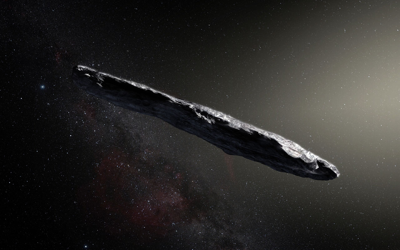 An artist's impression of the oddly shaped interstellar asteroid `Oumuamua'.