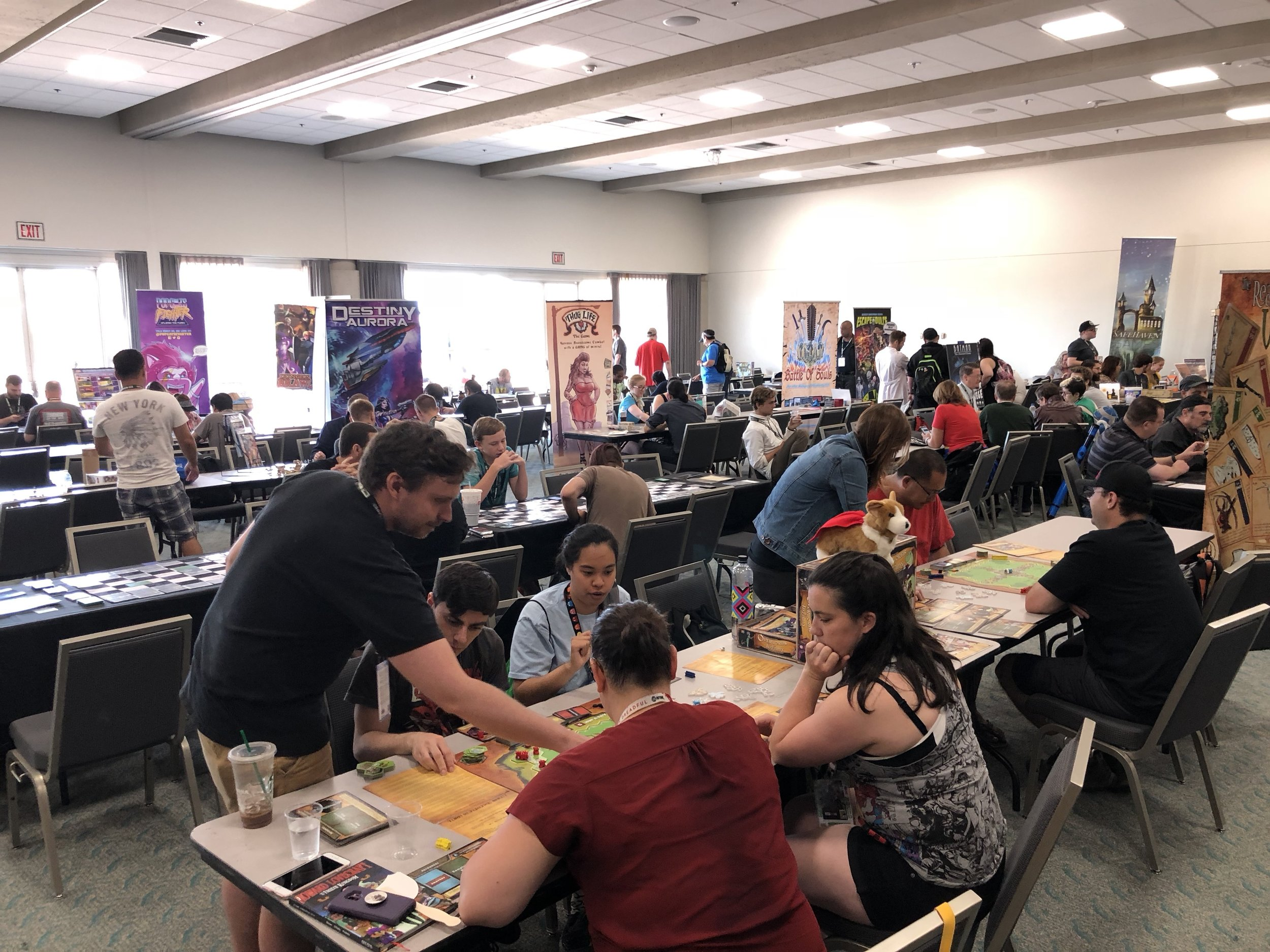 Gaming and Board games are a staple of most Comic Cons.  If you are are an enthusiast who likes supporting the cause or if you are just curious about up-and-coming new games, it's a worthy stop to make.   Game designers are friendly and passionate people, It's hard not to be inspired and root for them.