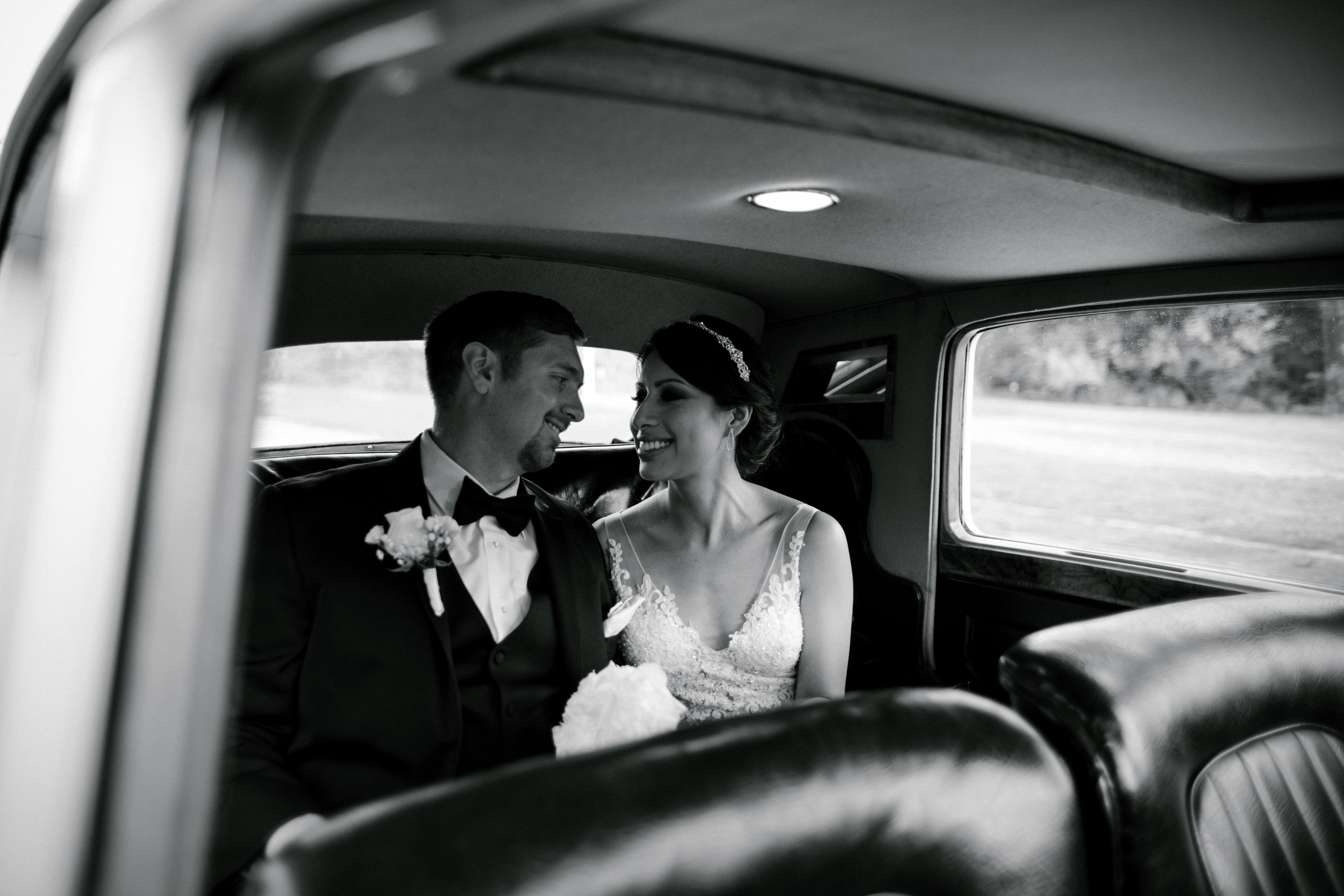 Couple portraits in a fancy antique car!