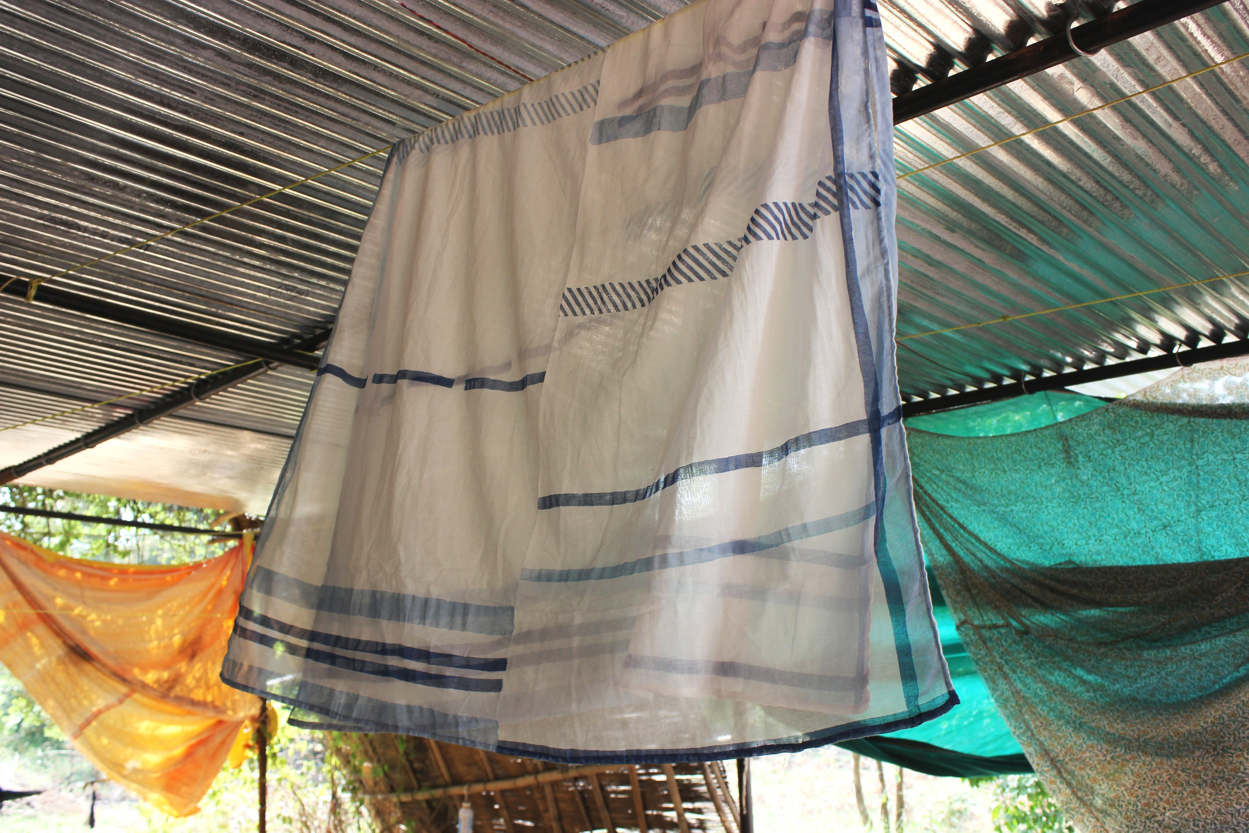A finished Indian Roller FLIGHT scarf - hung to dry before steaming which sets the colors.