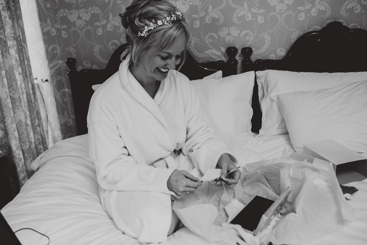 bride receiving gift from groom
