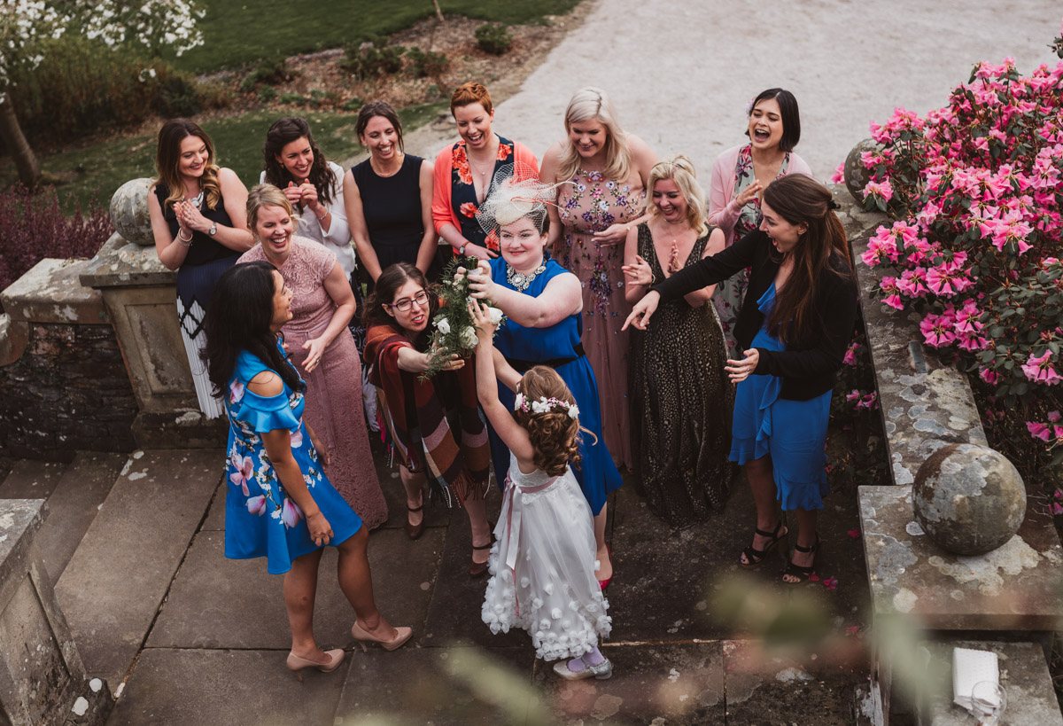 guests catching bouquet natural reactions