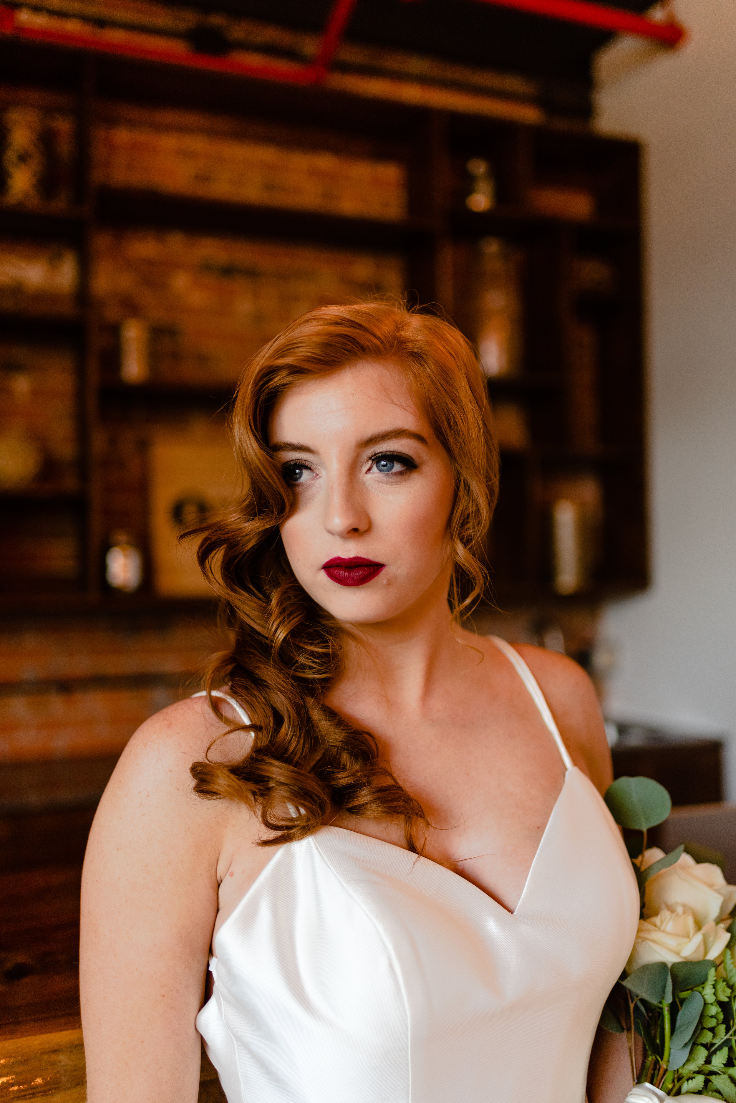"""4. Va Va Vintage   This look was another look that me and my team member Megan created for a """"Greatest Showman"""" styled bridal shoot at the charming industrial style Silk Mill venue located in Orange, Virginia . I absolutely love the vintage waves and bold burgundy red lip. This look is such a classic, and classics are always in style. This look is a statement maker."""