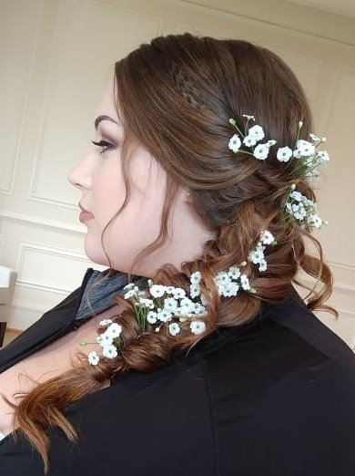3.1 Boho Braids   Braids were a big thing of 2018. I can't tell you how many of my brides wanted the lavish big braids and I was all to pleased to give it to them. I love braids and I hope the style sticks around for a while. Braids are pretty simple and sturdy but can look so intricate and detailed and can be dressed up with just about anything. Braids are perfect for the bride who wants to dance all night and not have to worry about her hair falling out or going limp.