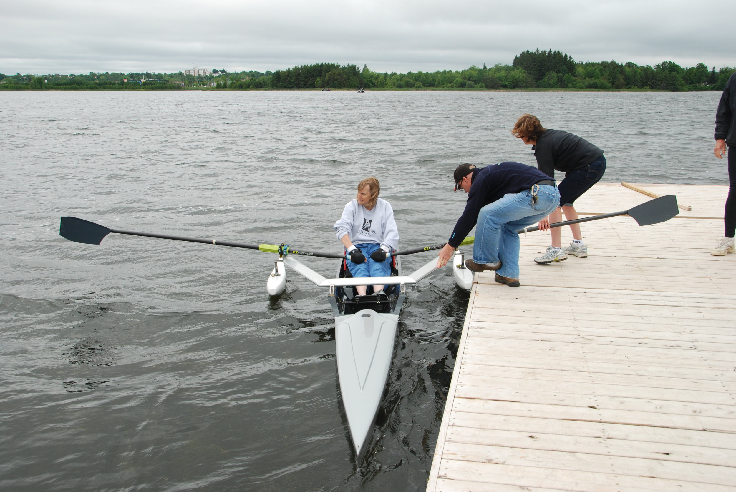 Helping Linda push off from the dock.JPG