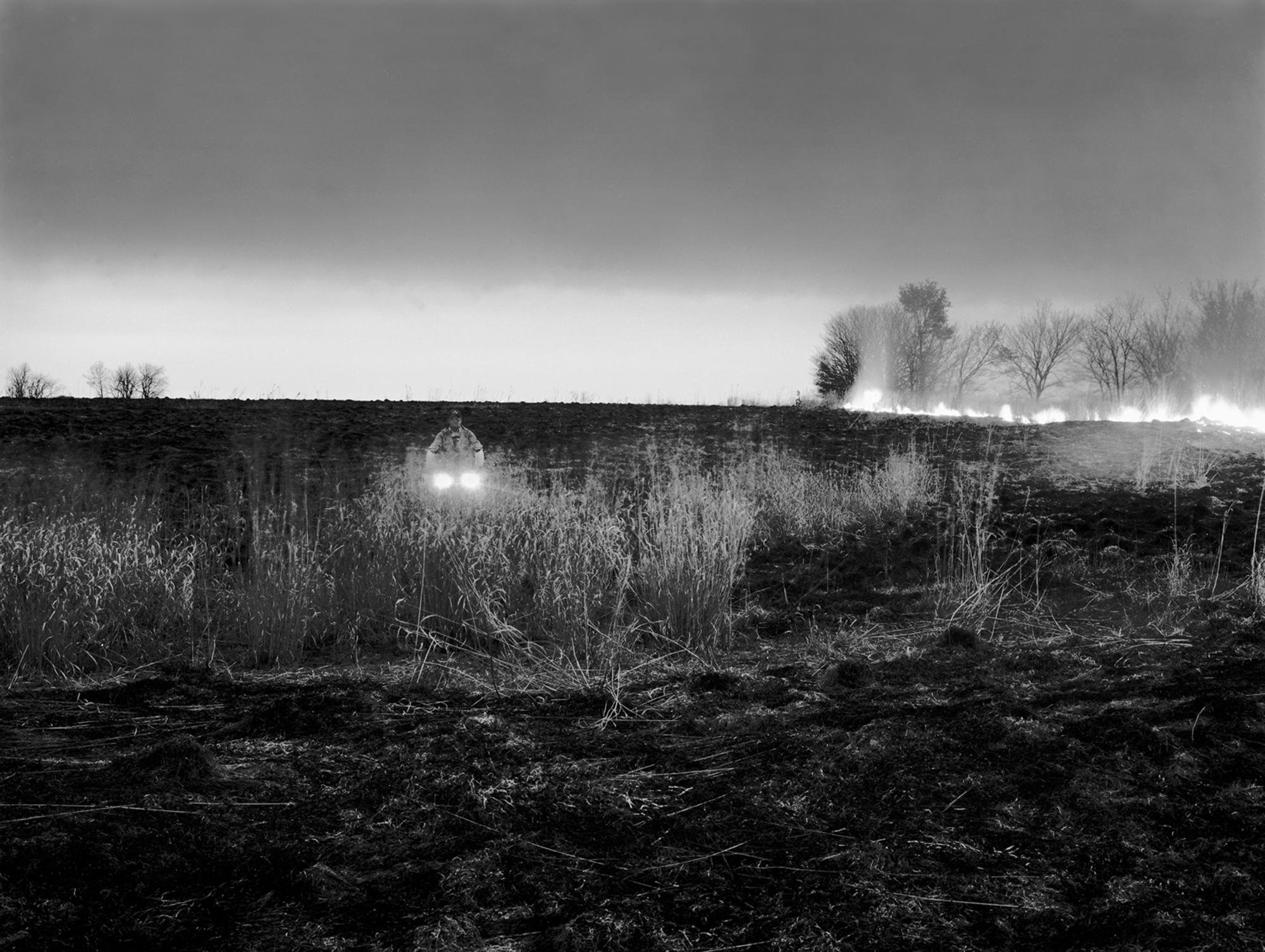 A rancher burning a field - Osage, KS.