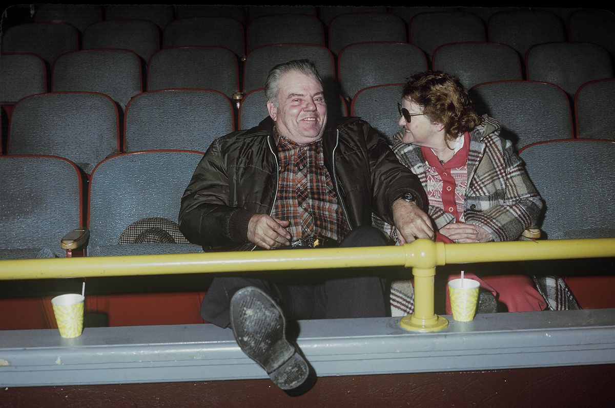 Couple watching big time wrestling