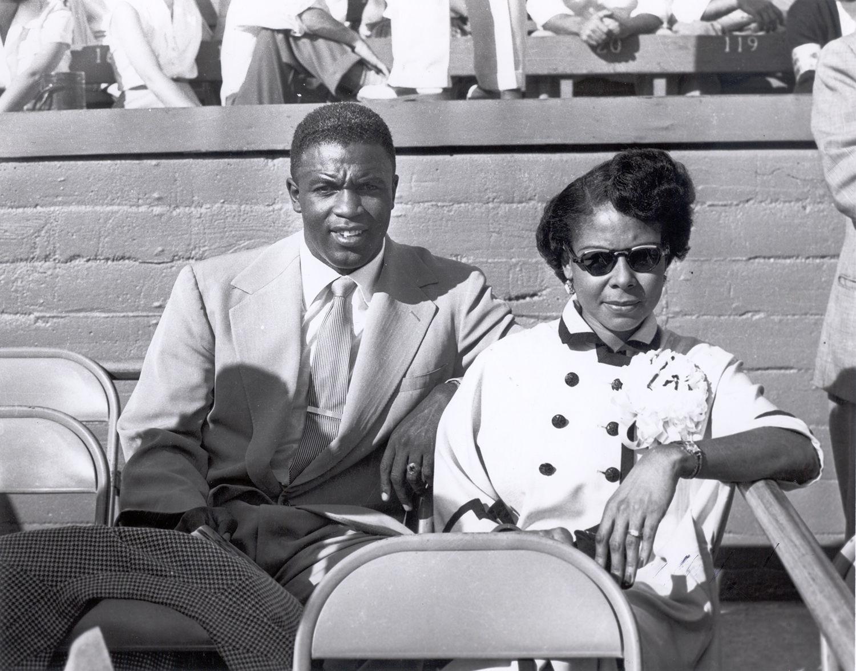 With his wife, Rachel Robinson.