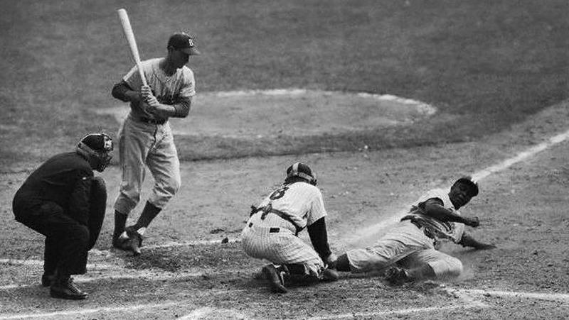 THE PASADENA WAY: Jackie Robinson steals home plate.