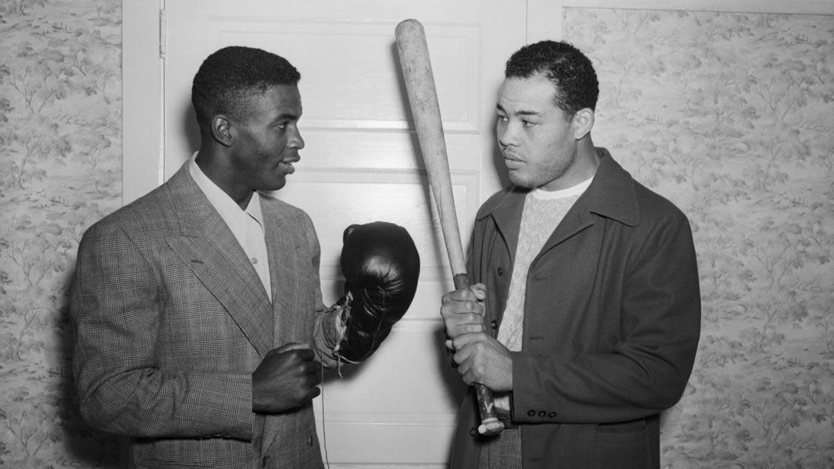 With boxing Champion Joe Louis