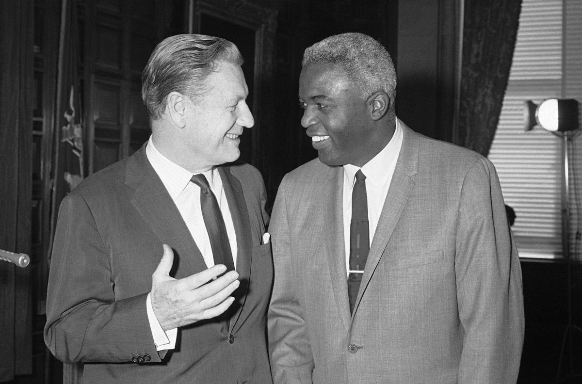 Jackie Robinson with Nelson Rockefeller.