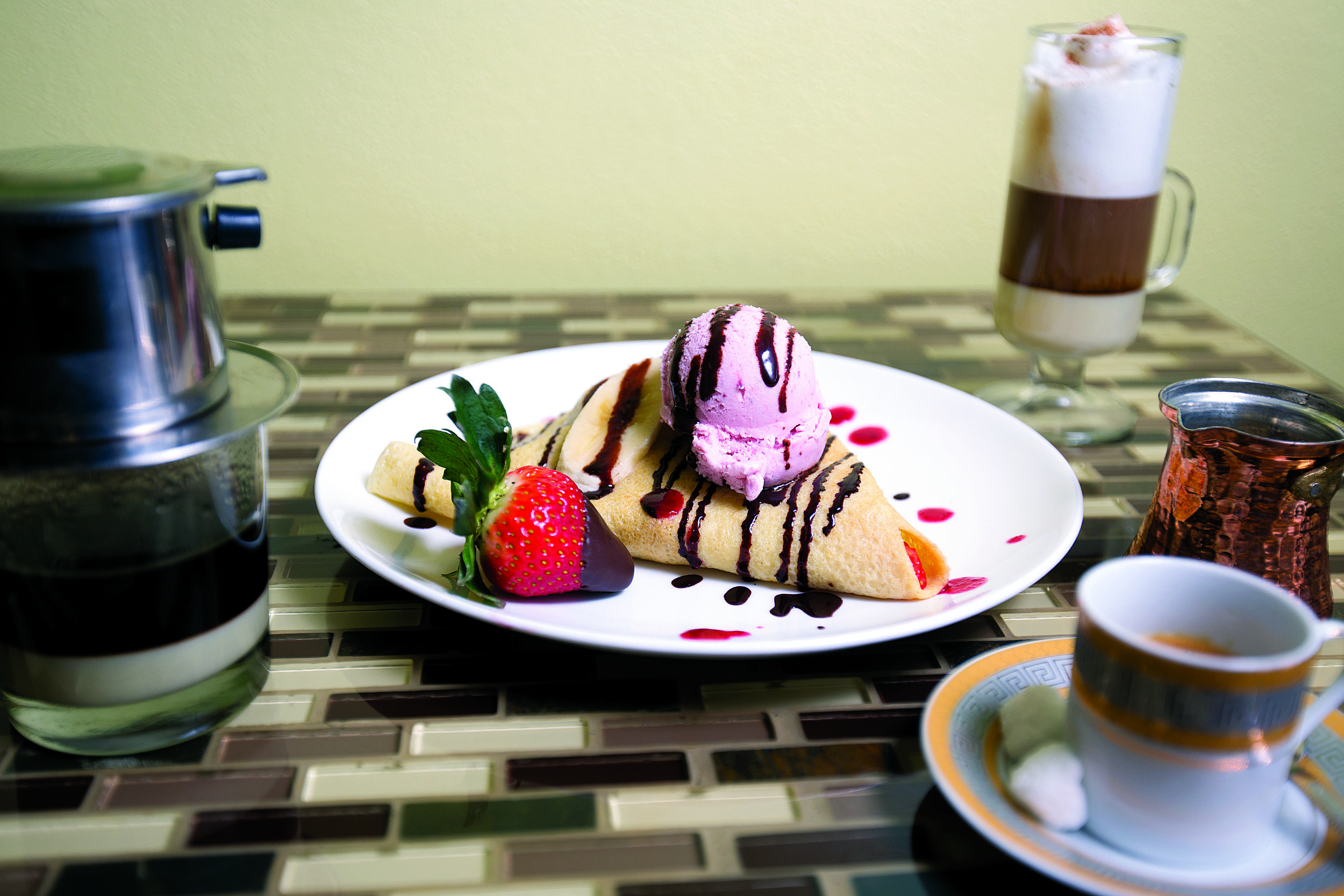 Try our specialty crepes with ice cream, or any of our delicious savory selections.