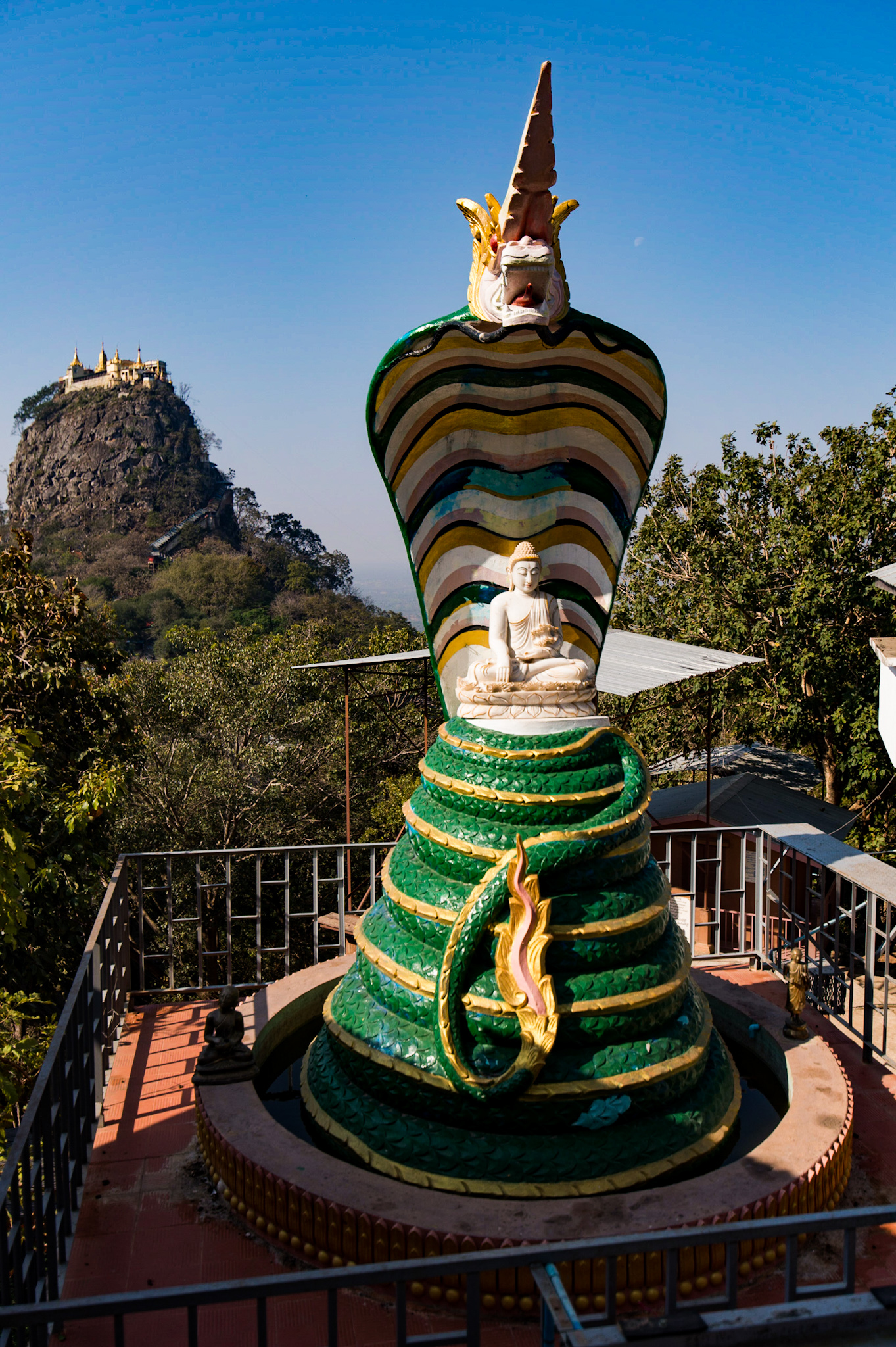 Mount Popa viewed from one of the first temples off the main road. Ignore the ten-foot-tall cobra Buddha...it was only for scale. 😉