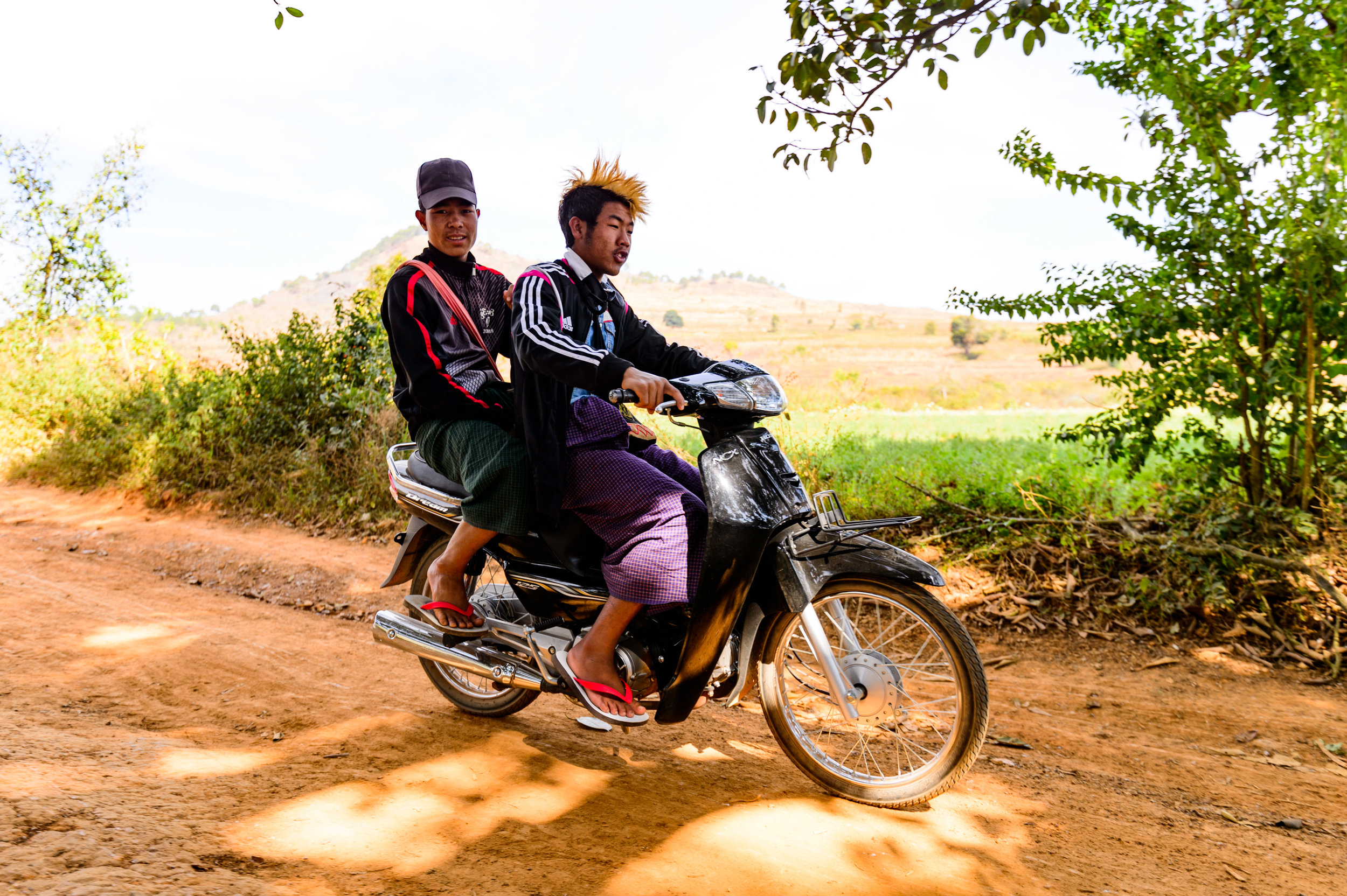 Typical Kalaw and/or Myanmar youth in general. Cool jackets/shirts, Longyi (unisex long skirt), and a friend with a Scooter. Good to go.