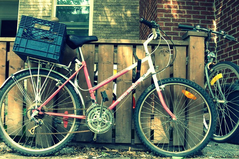 Pink delivery bike in the Plateau, Montreal via Lora Weaver Mysteries by Katy Leen