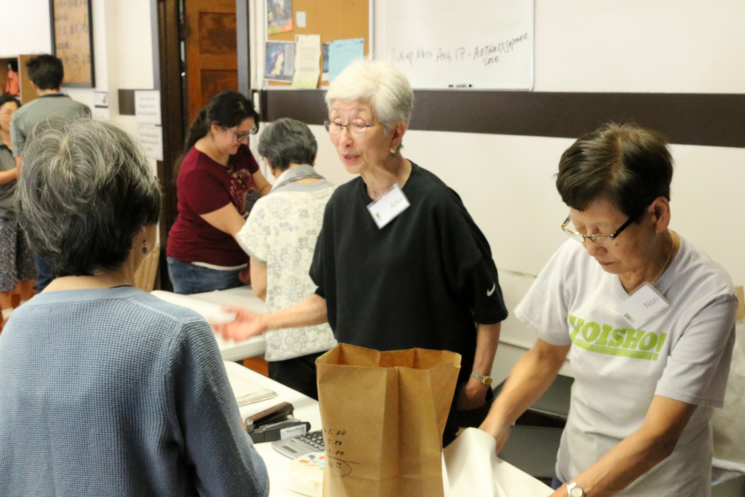 jcccw-yoshio-volunteer-table-staff.JPG