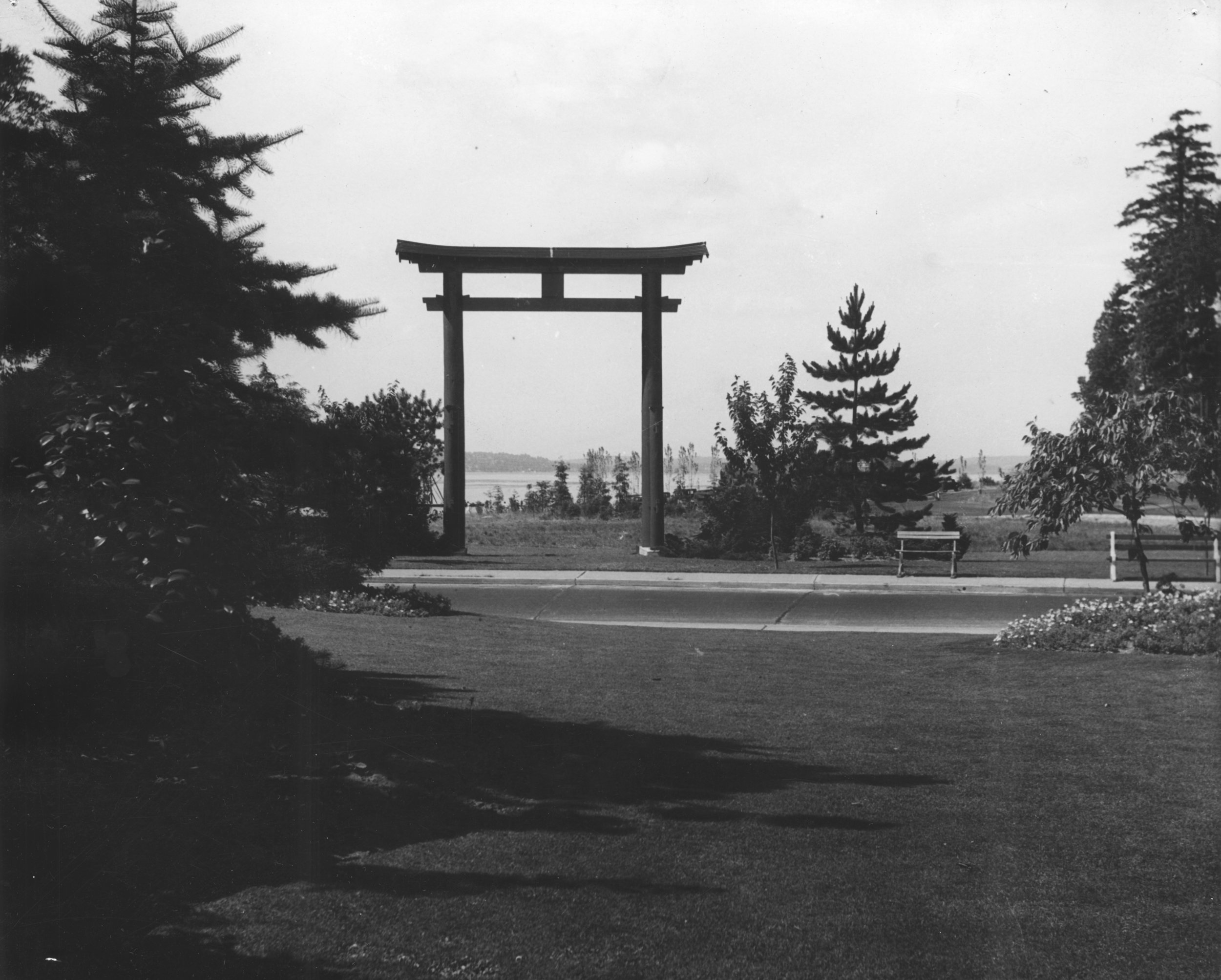 The Seward Park torii was designed by Allen K Arai, one of Seattle's first Asian architects. It was constructed in 1934 by Kichisaburo Ishimitsu on the Japanese Language School grounds and then anchored in downtown Seattle for the Golden Potlatch festival. It relocated to Seward Park in 1935.  Photo: Seattle Municipal Archives