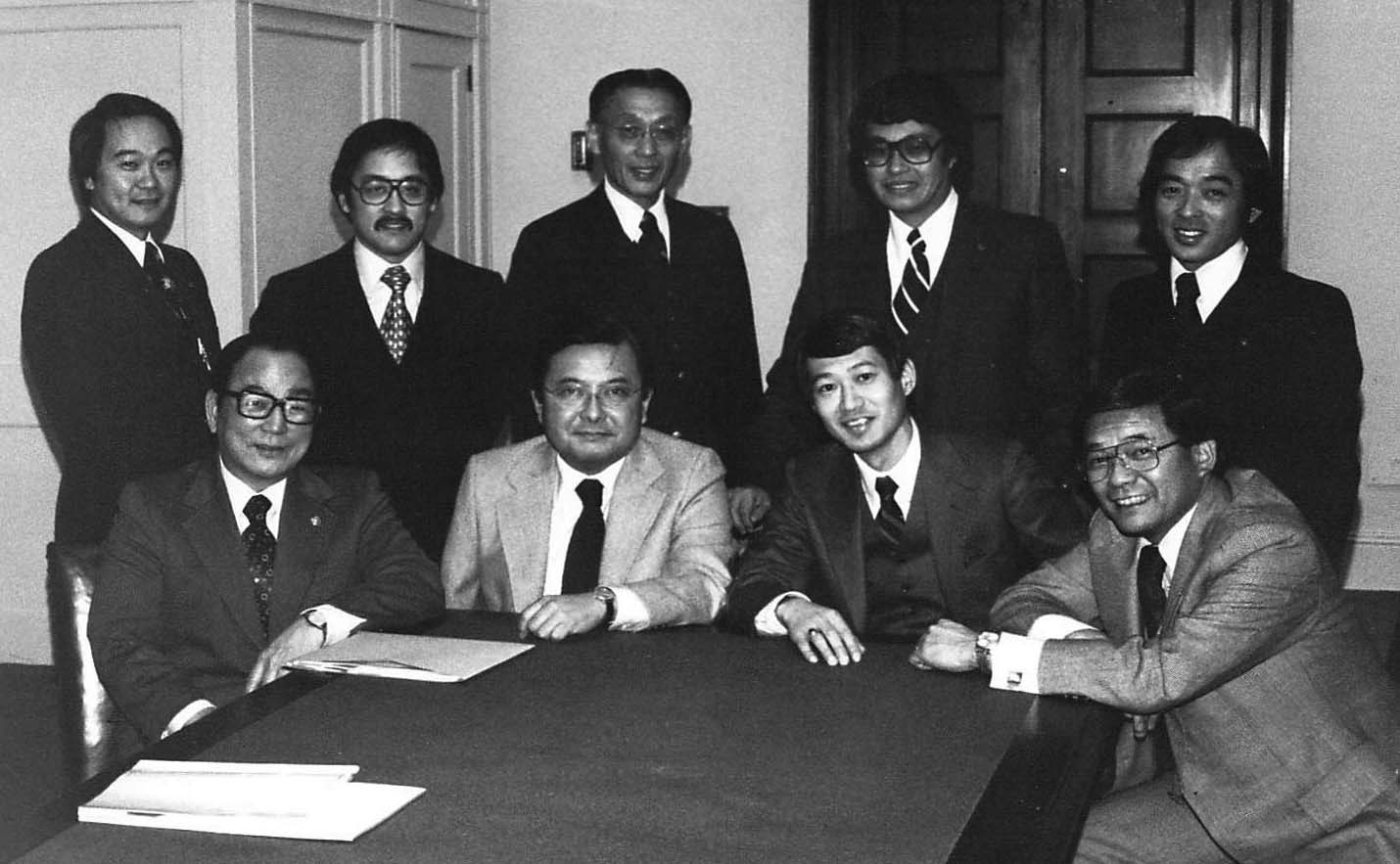 Ron Mamiya is seen in back row, second left, during a JACL's National Committee for Redress. Other people in the photo include (back, from left) Karl Nobuyuki, Ron Mamiya, Clifford Uyeda, Ron Ikejiri, and John Tateishi. They meet with the four JA members of Congress: (front, from left) Senator Spark Matsunaga, Senator Daniel Inouye, Rep. Robert Matsui, and Rep. Norman Mineta. Photo:  Ron Ikejiri / DiscoverNikkei.org