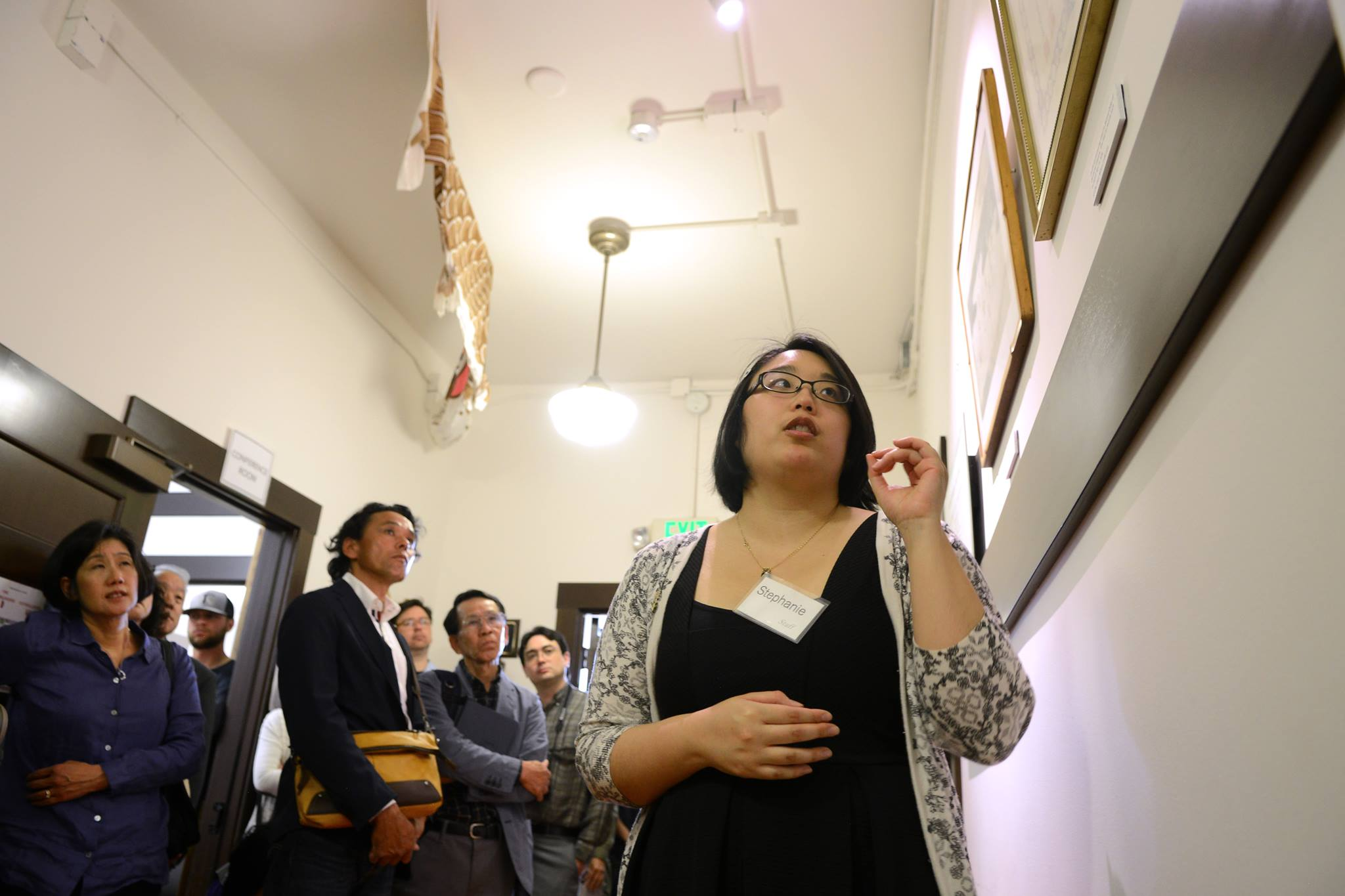 Stephanie Ikeda leads a tour of the  Genji Mihara: An Issei Pioneer  exhibit in May 2018.   Photo: Tyler Sipe