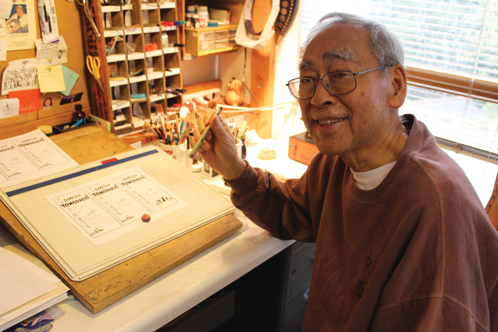 The late Sam Goto, creating an edition of his Seattle Tomodachi cartoon from his Mercer Island home.