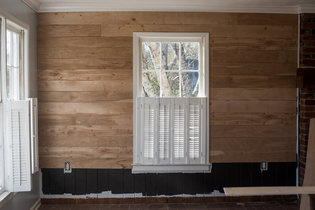 For shiplap, I first painted the walls black. Lesson learned don't paint the wall black LOL! Instead used black felt or roofing paper. Anyways, next I went to my local Home Deopt and bought quarter inch plywood and had them cut it into 6 inch slats. It was super easy to put up!   PC: Emily Reedstrom