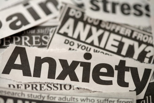 "Newspaper cutouts of the word ""Anxiety"""