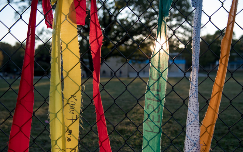 Students wrote a word or phrase on the length of fabric signifying a gift of peace that they bring to our school.