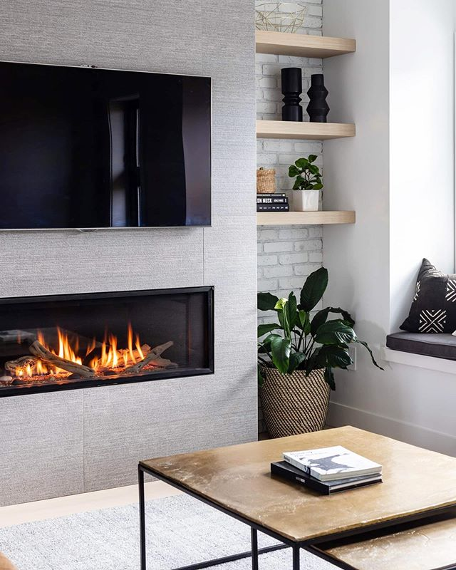 17TH AVE | Fireplace details in this cozy space we designed in Vancouver. #MD17thave