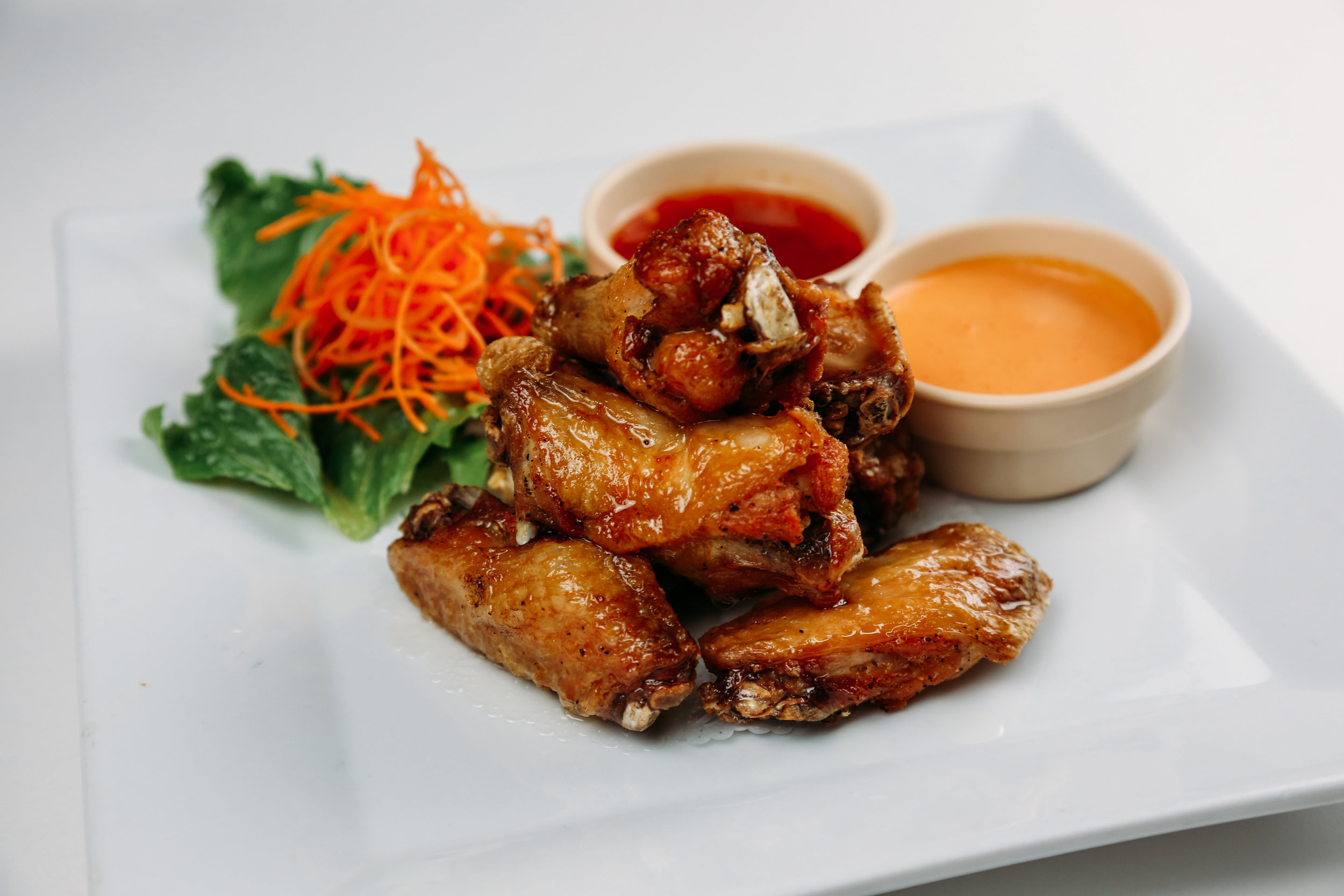 Thai chicken wings - Crisp chicken wings tossed in the wok with sweet chili sauce.
