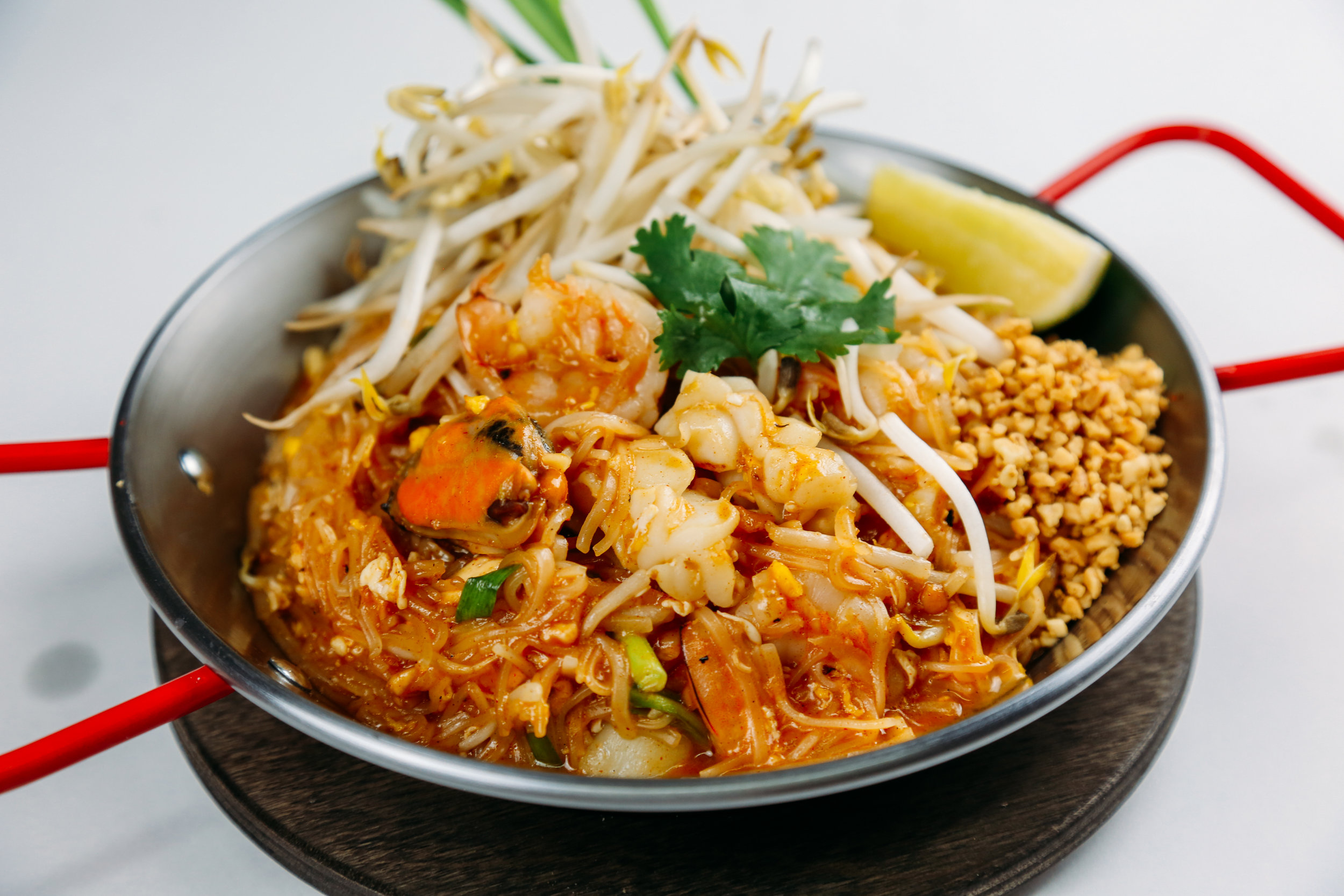 Pad Thai - Thin rice noodles or glass noodles, egg,Thai chive, bean sprouts androasted peanut with tamarine sauce.