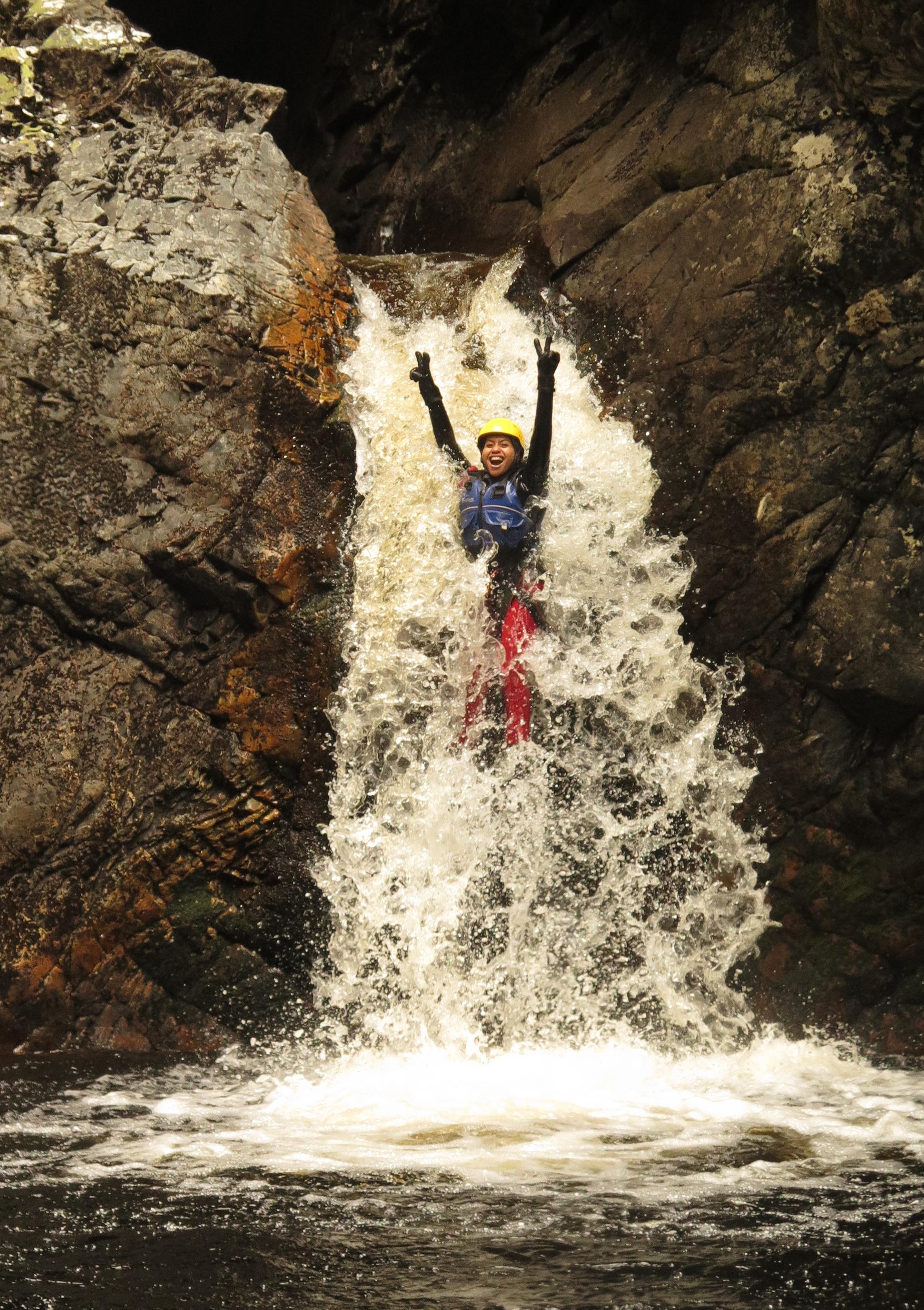 Waterfall slide on canyoning tour, Cradle Mountain, Tasmania