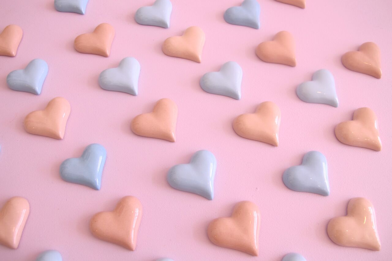 little ceramic hearts which we bake into your cake for you so you can reveal the gender of your baby without food colouring.jpg