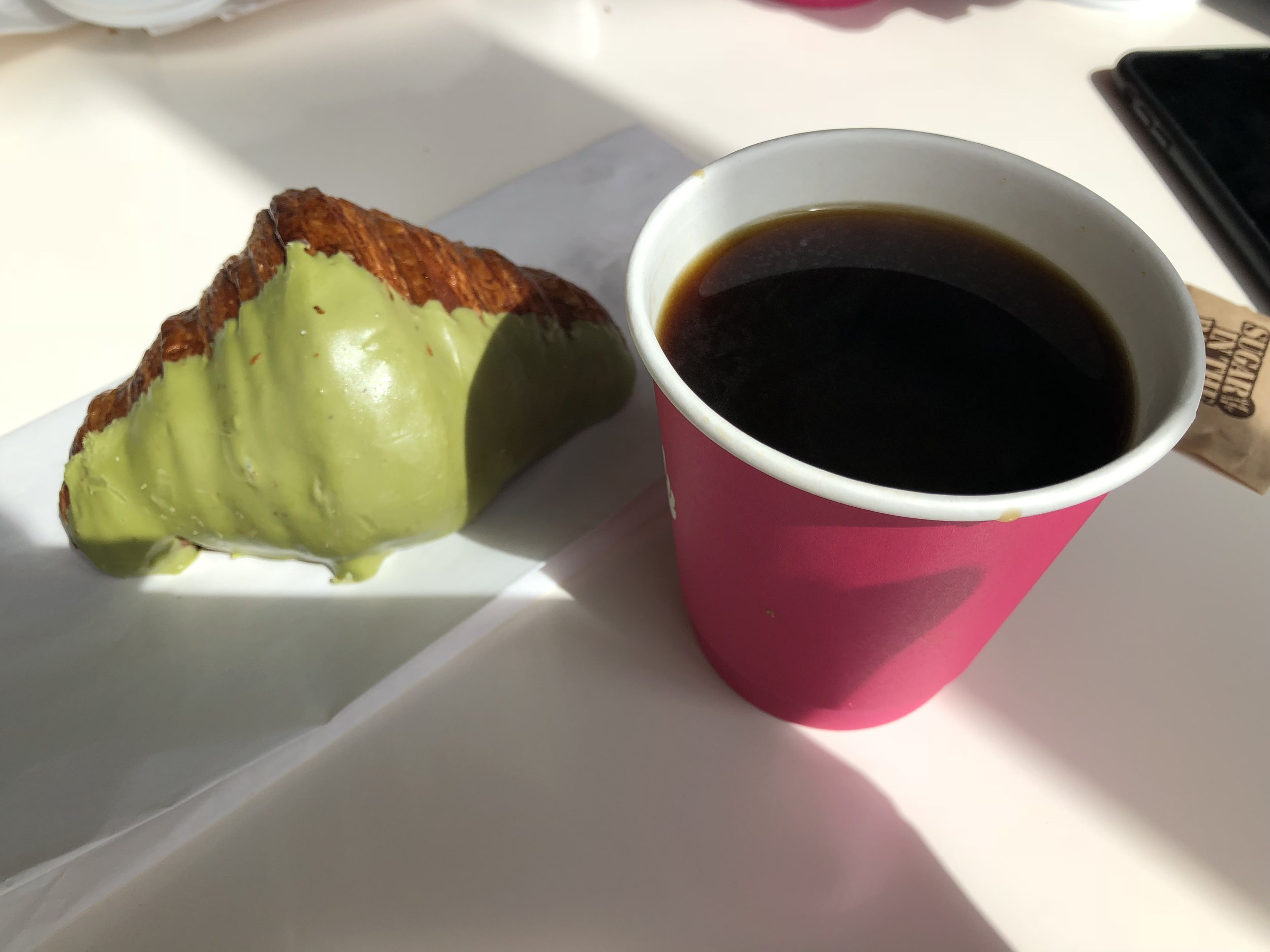 Sometimes only doughnuts and pastries will do, so it's worth getting the best if you're gonna give in to the cravings. Head to  Mr   Holmes Bakehouse  for just that. When I went I missed out on the famous cruffins, but this matcha dipped croissant was insane, as was the creme brulee one.