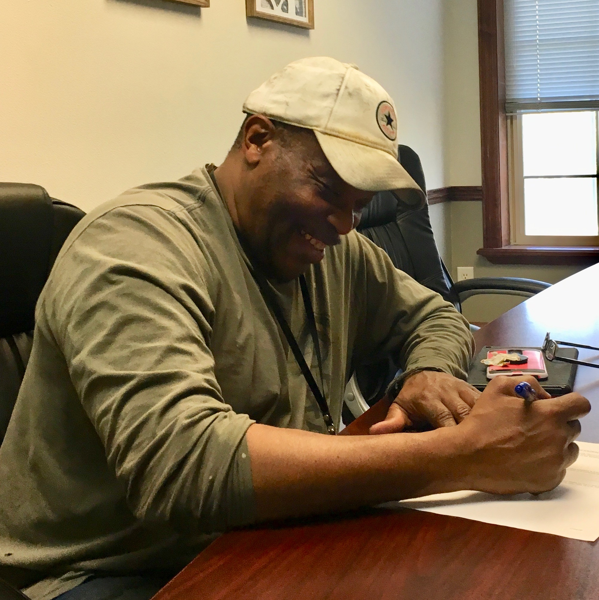 Our first client, Vaughn, signing the paperwork to close on his new home.