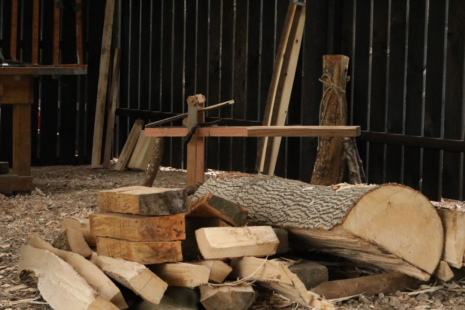 Logs after splitting piled in blanks
