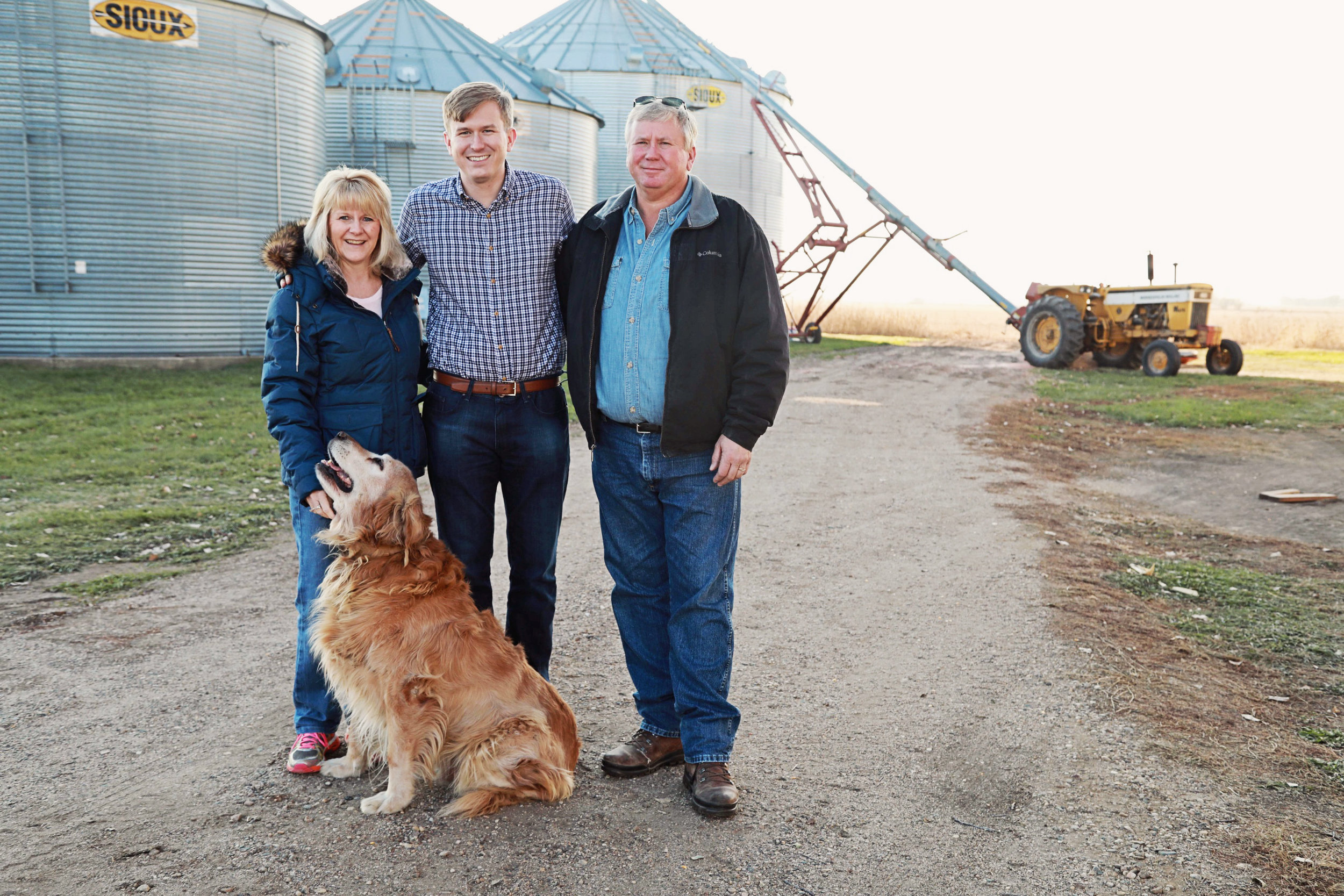 Ryan with his mom Traci and dad David and the family dog Bo at the family farm.