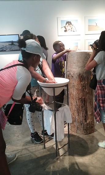 Students washing their hands in the gallery