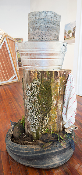 River soap wash tub,  soap, log, tub, water, hand towel, found tire and trash, compost.