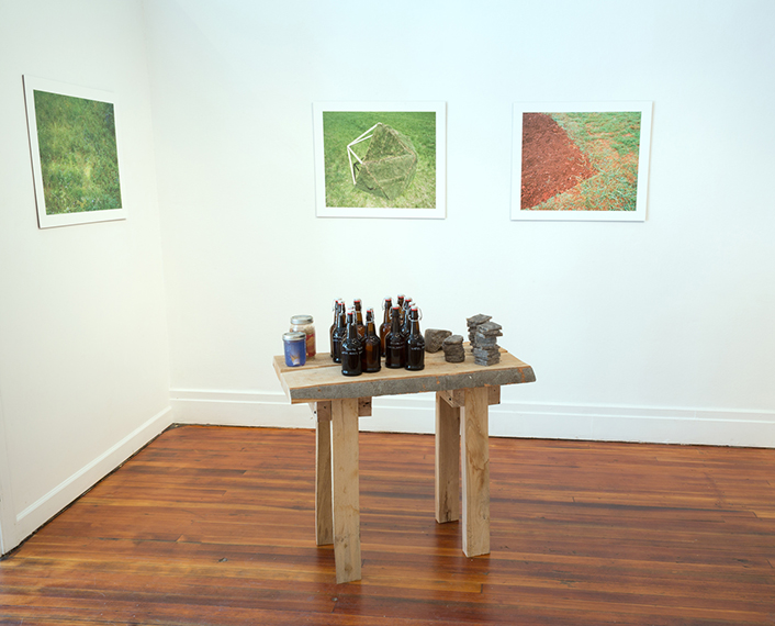 Installation view of takeaways and photographs.