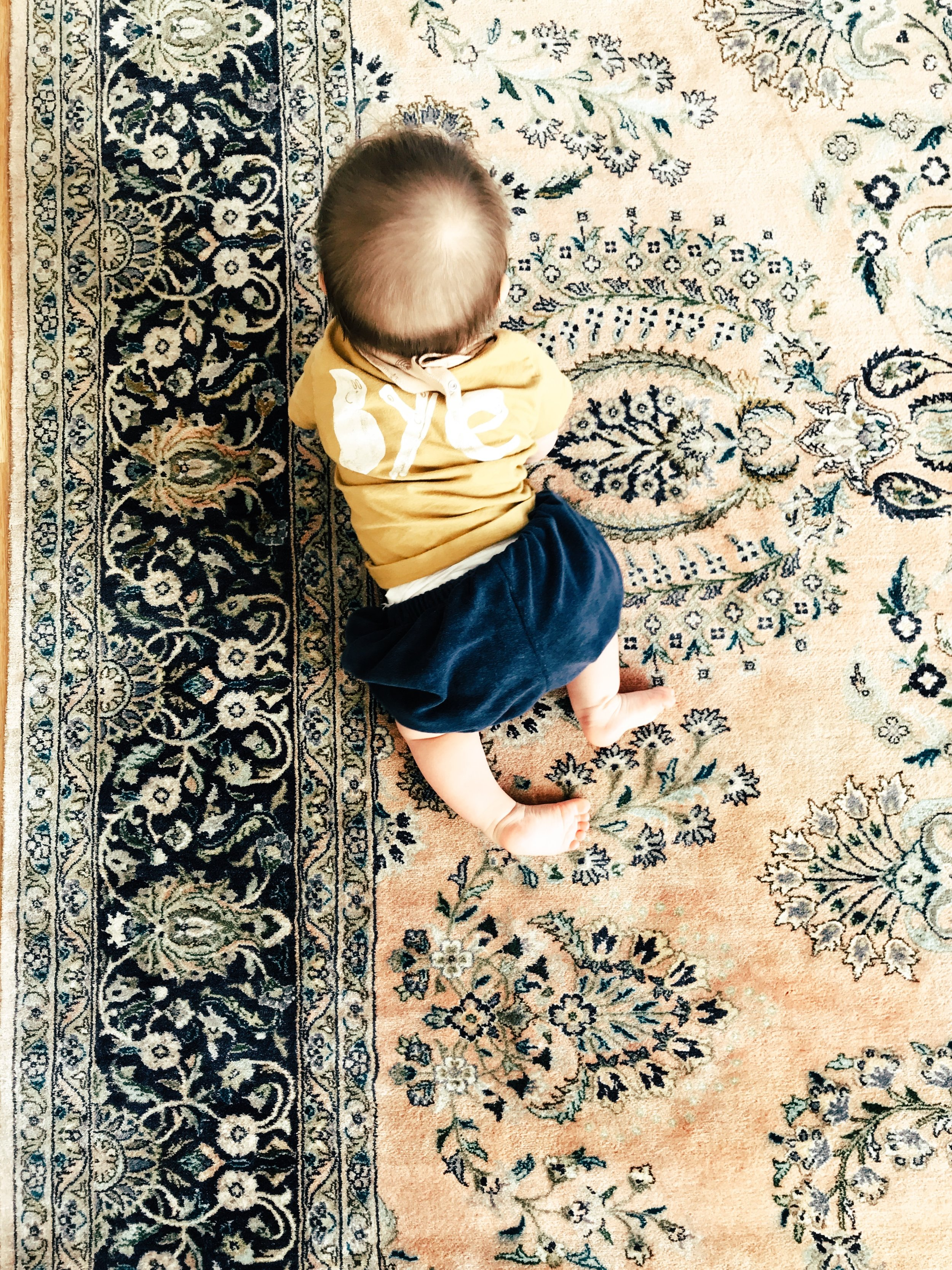 faded vintage persian rug baby crawling soft colours meaningful home #littlepeoplelivehere how to let go of stuff declutter inheritance the inheritance of things ourstorytime.co.uk