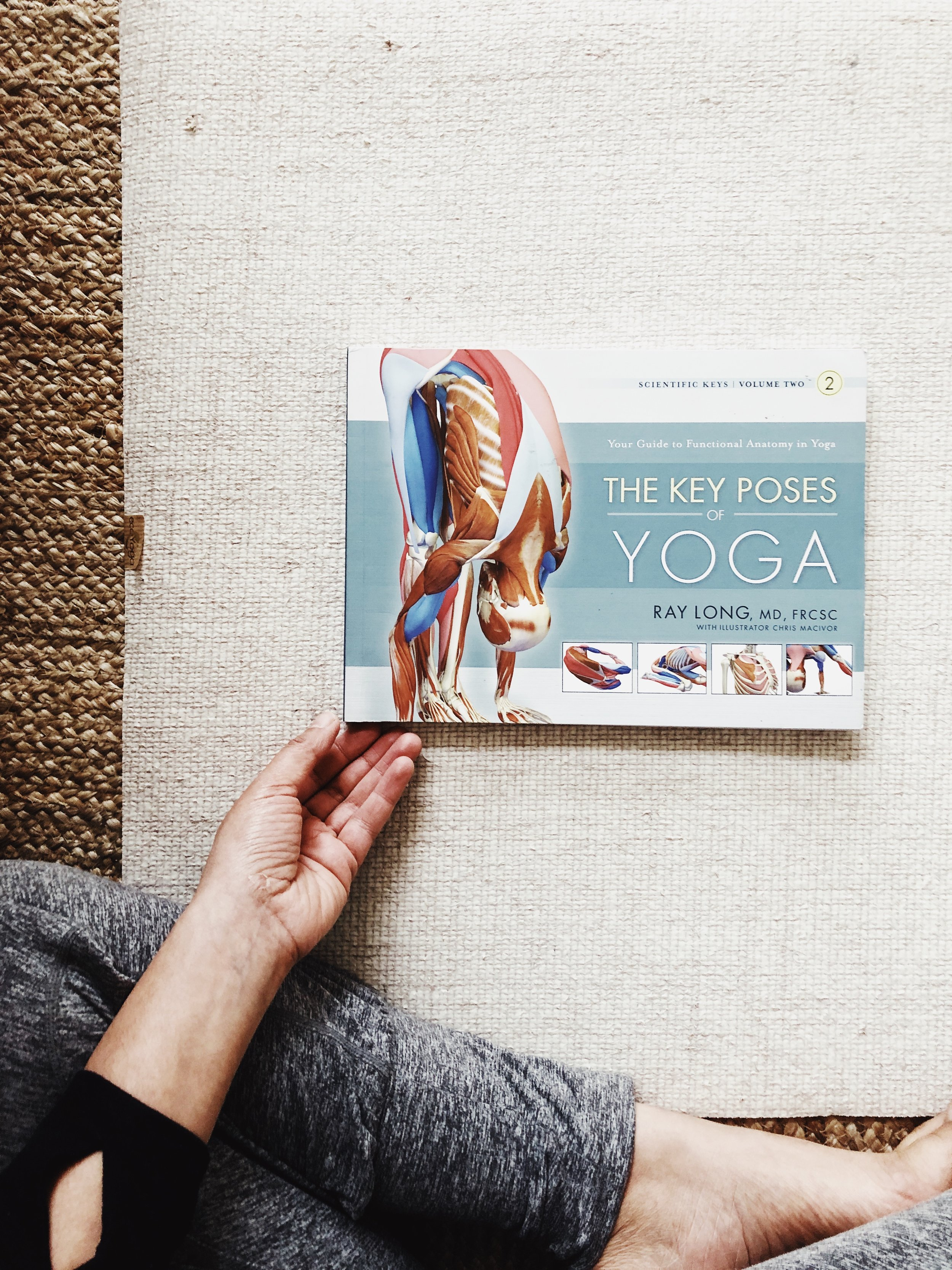 cream natural yoga mat with ray long text book on top