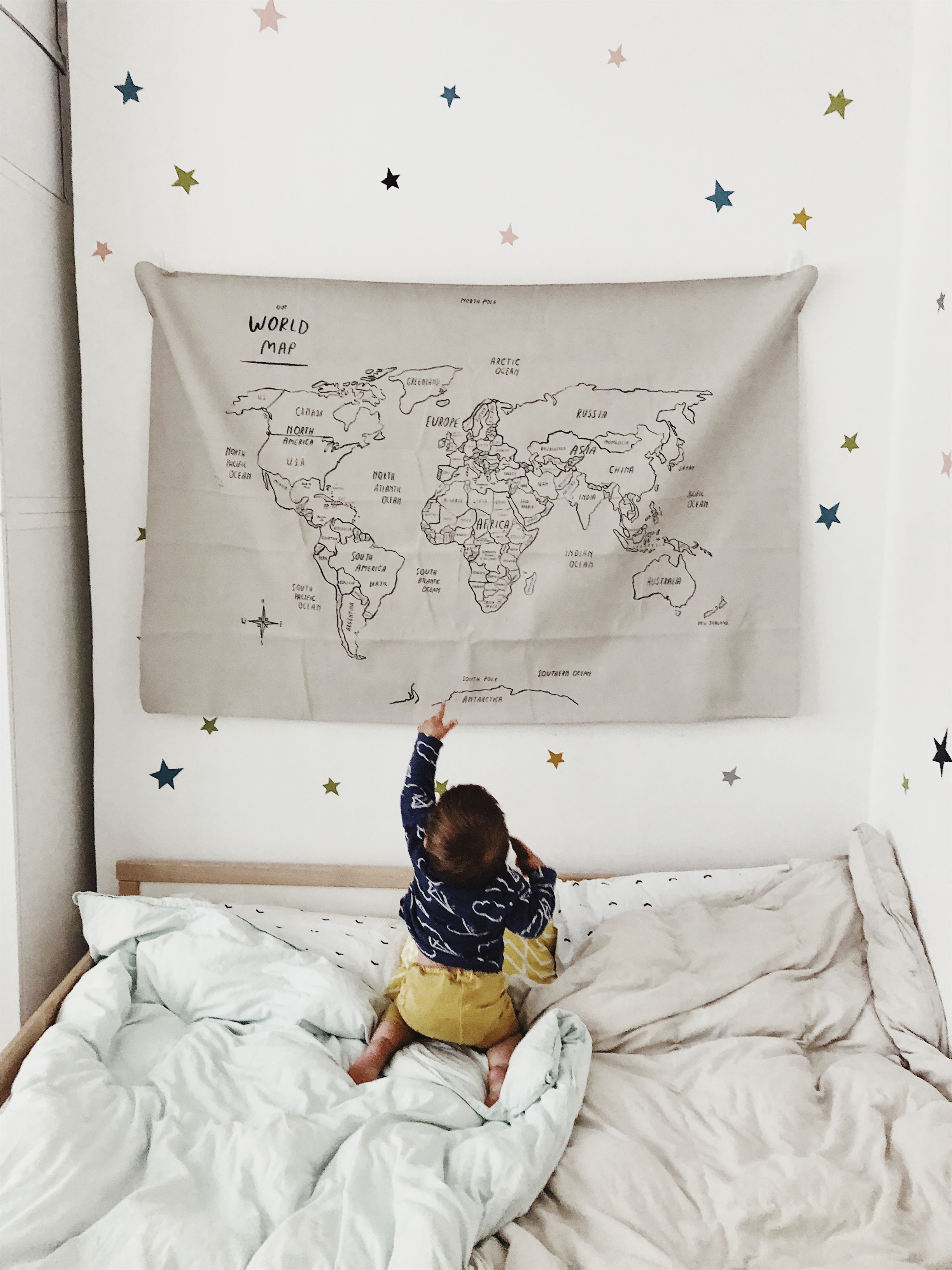 A little boy, reaching up at a world map. Trying to understand Brexit. More on my blog, Our Story Time.