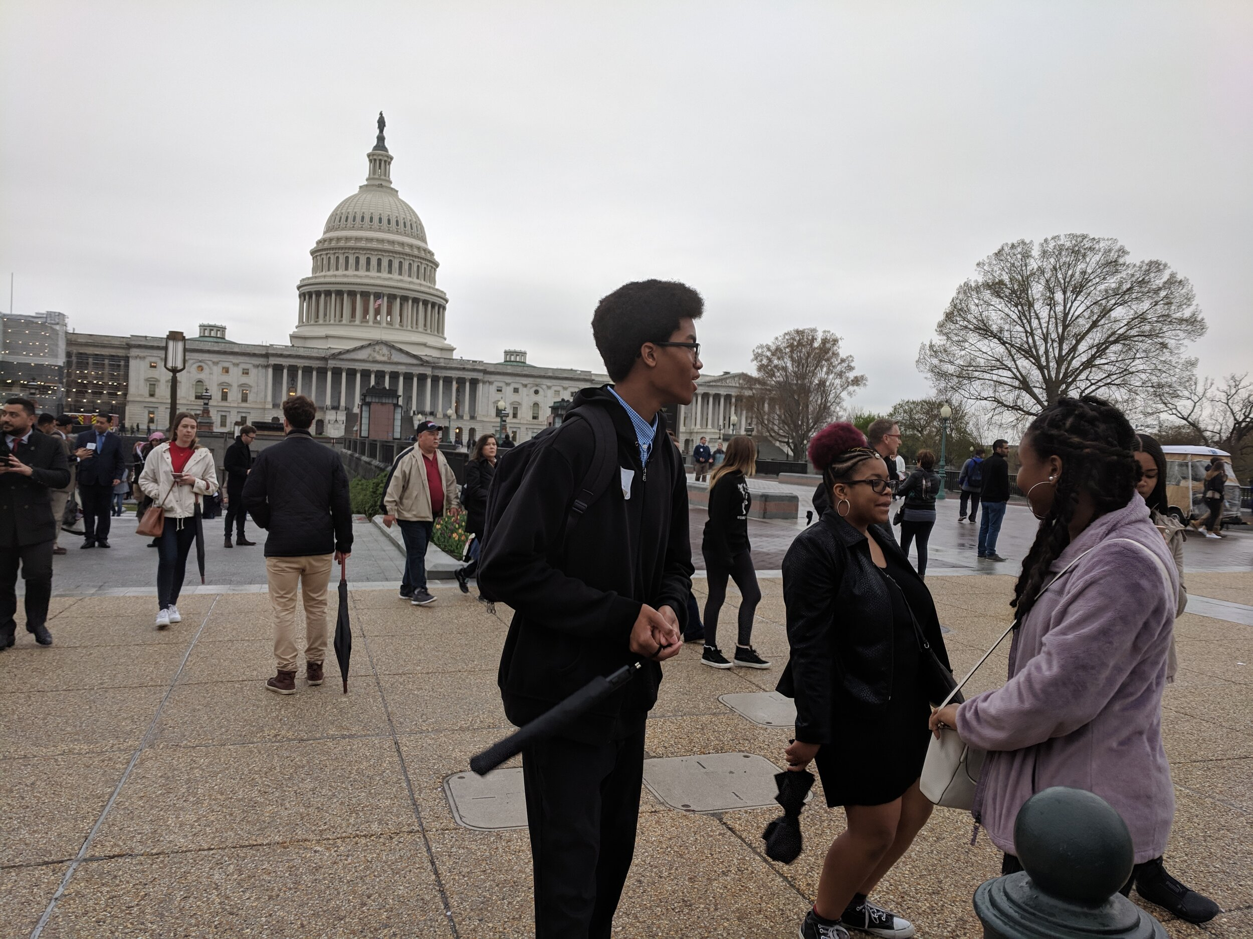 """""""…I thought my history was about slavery, and then 'here we are.' But there's much more to our history, and it makes me think I could do anything."""" Chris Rhodes Sophomore (2018-2019 Grand Prize Winner) in front of the Capital."""